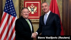 U.S. Secretary of State Mike Pompeo (left) shakes hands with Montenegrin President Milo Djukanovic during a meeting in Podgorica on October 4.