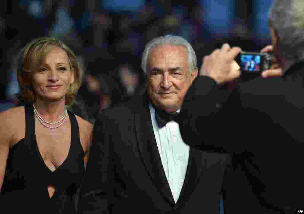 "Former IMF chief Dominique Strauss-Kahn and marketing executive Myriam L'Aouffir arrive in Cannes to attend the screening of the film ""Only Lovers Left Alive."" (AFP/Alberto Pizzoli)"