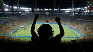 Five-year-old Joaquim Villano of Rio de Janeiro celebrates on the shoulders of his uncle after Brazil defeated Germany in the men's soccer gold-medal match at the Rio 2016 Olympic Games.