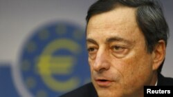 New ECB President Mario Draghi speaks during his first news conference in Frankfurt on November 3.