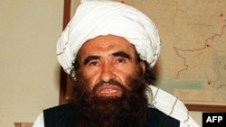 Pakistan - Founder of the Haqqani network Maulvi Jalaluddin Haqqani, gestures as he speaks with a group of media representatives in Pakistan's city of Islamabad, October 19, 2001