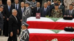 Lebanese President Michel Suleiman pays his respects to intelligence chief Wissam al-Hassan and bodyguard Ahmed Sahyouni at a funeral on October 21 for the slain men, who died in a bomb explosion on October 19.