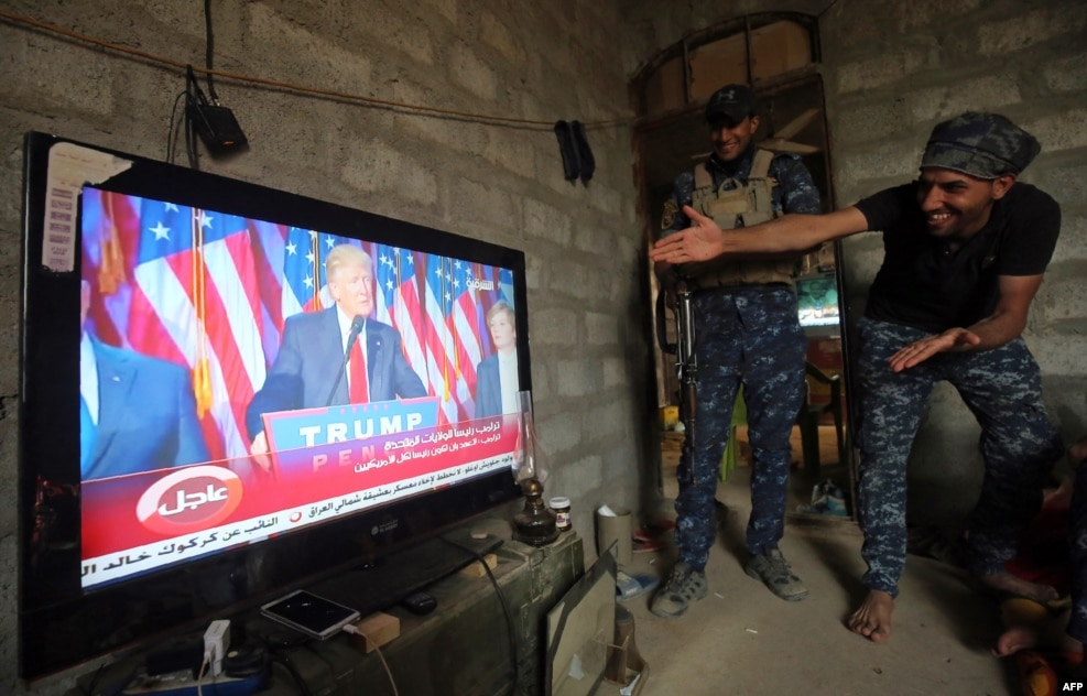 Members of the Iraqi armed forces in the village of Arbid on the southern outskirts of Mosul react as they watch U.S. President-elect Donald Trump giving his victory speech during ongoing military operations to retake Mosul from the Islamic State extremist group. (AFP/Ahmad al-Rubaye)