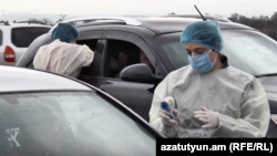 Armenia - Medical workers screen citizens for coronavirus-like symptoms before allowing exit from Vagharshapat, March 16, 2020