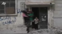 Syrians Flee Ongoing Fighting In Homs