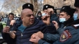 Armenian police detain a protester during a February rally in Yerevan to demand the resignation of the prime minister, who they say mishandled the war with Azerbaijan.