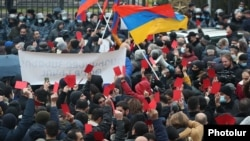 Armenia -- Opposition supporters demonstrate outside the parliament building in Yerevan, December 9, 2020.
