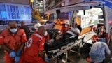 LEBANON -- Medics shift an injured person from Najjar Hospital to another hospital in Al-Hamra area in Beirut after Port explosion, in Beirut, Lebanon, 04 August 2020.