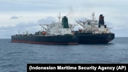 The seized tankers are seen anchored together in waters off the island of Borneo.