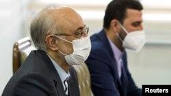 The head of Iran's Atomic Energy Organization Ali Akbar Salehi (left) speaks during a meeting with IAEA Director-General Rafael Grossi in Tehran on February 21.