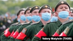 Russian soldiers wearing protective face masks take part in a Victory Day parade rehearsal at a military airfield near Rostov-on-Don on June 4.