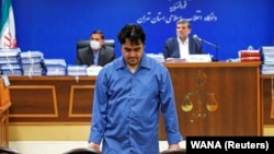 Ruhollah Zam, a dissident journalist who was captured in what Tehran called an intelligence operation, is seen during his trial in Tehran in June.