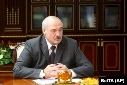 """On August 9, the first anniversary of the disputed vote, Belarusian leader Alyaksandr Lukashenka dismissed """"those nasty things that you throw into my face, saying that I'm a dictator."""" (file photo)"""