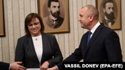 The leader of the Bulgarian Socialist Party, Cornelia Ninova (left), returns the mandate to form a government to President Rumen Radev (right) during their meeting in Sofia on September 7.