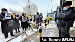 Protesters outside the consulate in Almaty say their relatives have been illegally held in China.