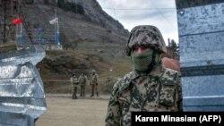 NAGORNO-KARABAKH -- Azerbaijani soldiers patrol at a checkpoint on a road outside the town of Shushi (Susa), November 26, 2020.