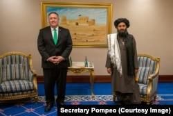 U.S. Secretary Of State Mike Pompeo and deputy Taliban leader Mullah Beradar in Qatar on September 14.