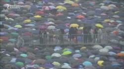 Hong Kong Protesters Gather Despite Beijing Warnings, Downpour