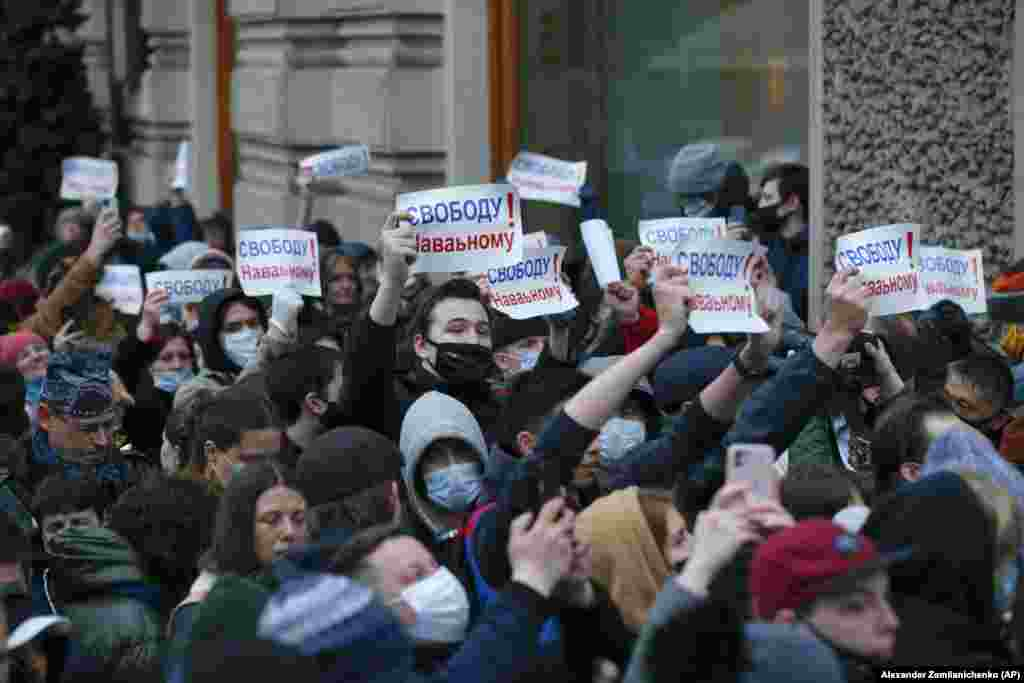 """Protesters in Moscow march holding signs reading """"Freedom for Navalny!""""Navalny went on a hunger strike to demand doctors treat him for severe pain in his back and legs, and his health is reportedly deteriorating."""