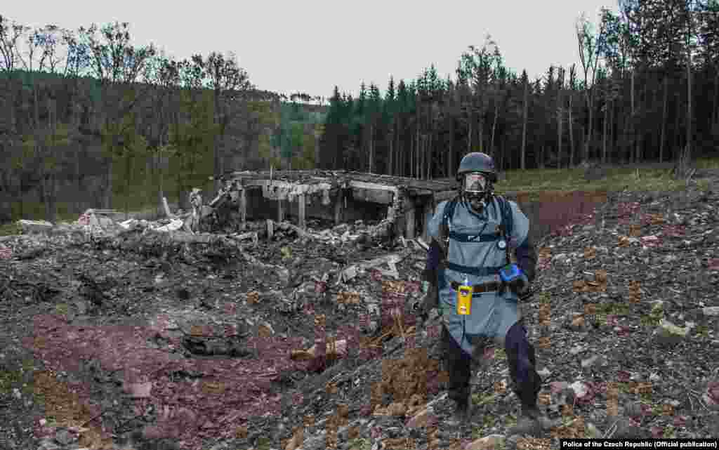 "A pyrotechnician inspects the site after the deadly blast in 2014. There is ""reasonable suspicion regarding a role of members of Russian military intelligence…in the explosion,"" Czech Prime Minister Andrej Babis said on April 17."