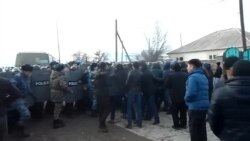 Kazakh Protesters Scuffle With Police After Killing Of Boy