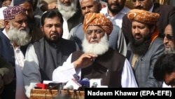 Ikramur Rehman was affiliated with the party of firebrand cleric Maulana Fazlur Rehman (center), who heads an 11-party opposition alliance to topple the government.