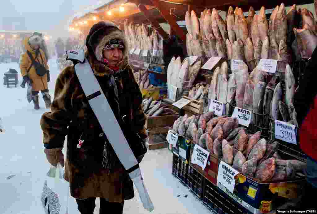 A woman shops for fish at a market in freezing conditions of minus 43 degrees Celsius in the city of Yakutsk, Yakhutia. Located in Russia's Far East, Yakutia is known for its severe climate. (TASS/Yevgeny Sofroneyev)