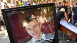 'People Should Be Held Responsible': Mother Of Dead Belarusian Demands Criminal Inquiry