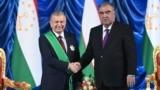 Uzbek President Shavkat Mirziyoev (left) and his Tajik counterpart, Emomali Rahmon, in Dushanbe on June 10. The new Uzbek leader has helped establish a much friendlier relationship with Tajikistan.