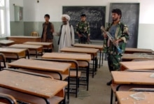 Afghanistan - Afghan National Army inspect a Primary school, after a bomb blast, in Spin Boldak town, 21Apr2006