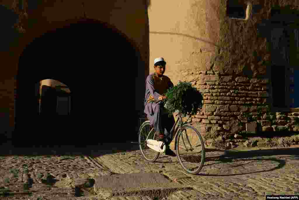 A young boy rides his bicycle in the old part of Herat, Afghanistan. (AFP/Hoshang Hashimi)