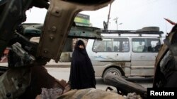 A woman looks at the site of a bomb attack in Baghdad's Sadr City on November 18.