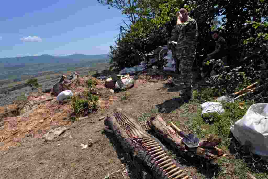 South Ossetian fighters take up positions near Tskhinvali on August 8.