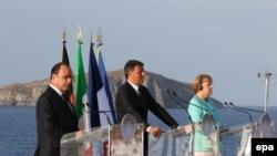 Франсуа Олланд, Маттео Ренци и Ангела Меркель во время встречи на острове Вентотене