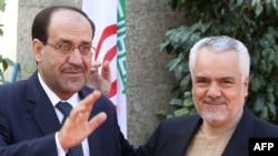 Iran's First Vice President Mohammad Reza Rahimi (right) welcomes Iraqi Prime Minister Nuri al-Maliki to Tehran.