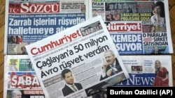 TURKEY -- Front pages of some of Turkish newspapers with headlines concerning a trial in New York against a Turkish banker charged with violating U.S. sanctions against Iran, in Ankara, November 30, 2017
