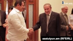 Armenia - A screenshot of ilur.am video of a meeting between former President Levon Ter-Petrosian (R) and businessman Gagik Tsarukian, 9Sep2014.
