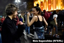 Protesters dance in front of the Georgian parliament in Tbilisi on the night of May 13.
