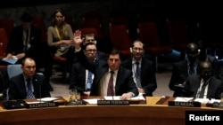 Moscow's Deputy Ambassador to the UN Vladimir Safronkov (center) voted against the UN Security Resolution to impose sanctions on Syrian officials.