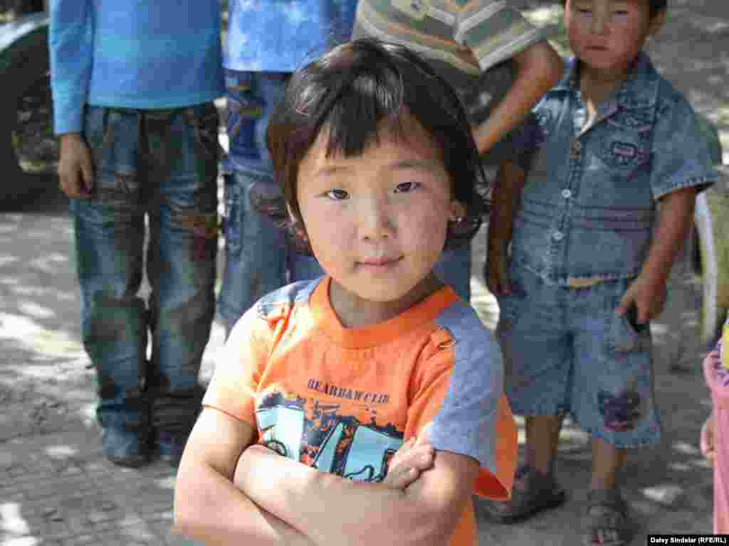 A little girl at Kindergarten No. 30 in central Osh, in southern Kyrgyzstan, who really knows how to strike a pose. She asked to have her picture taken several times.Photo by Daisy Sindelar for RFE/RL