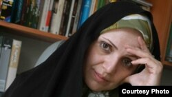 A file photo of Iranian women's rights activist and journalist Fariba Davoodi Mohajer, who now lives in the United States, in her head scarf