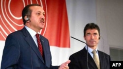 Turkey's Recep Tayyip Erdogan (left) has come out against the candidacy of Danish Prime Minister Anders Fogh Rasmussen as NATO chief.