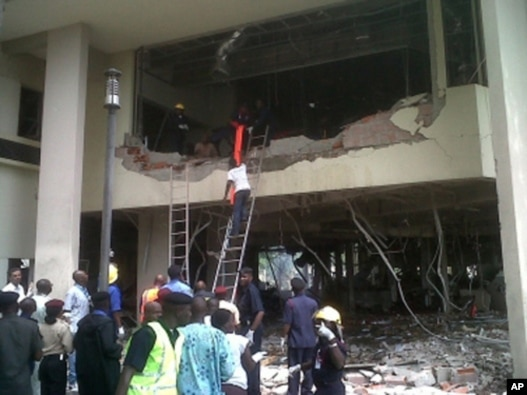 Firefighters and rescue workers hunt for survivors at the UN's Abuja office.