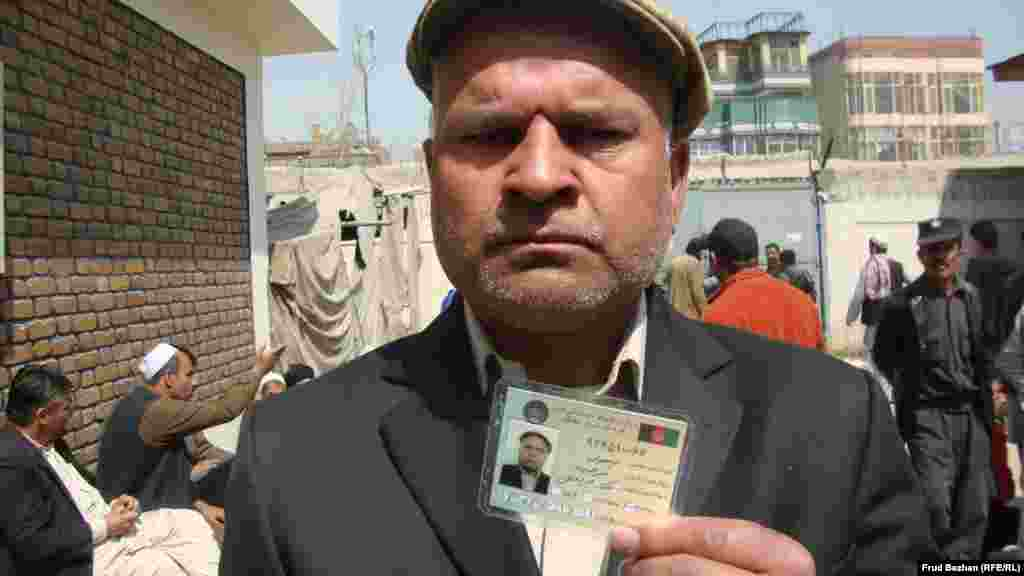 Kabul resident Zulgai gets his first voting card.
