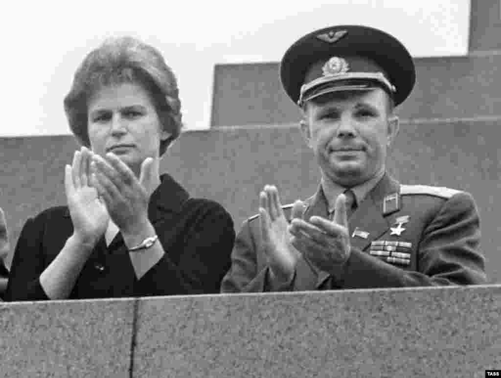 Tereshkova with cosmonaut Yury Gagarin, the first man in space, at Lenin's mausoleum in Red Square in 1963