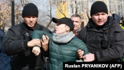 Kazakh police detain a protester in Almaty on February 22.
