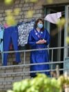 UKRAINE - A resident stands on the balcony of a hostel closed for hard quarantine due to an outbreak of the COVID-19 coronavirus in the small Ukrainian town of Vyshneve outside Kyiv on April 24, 2020