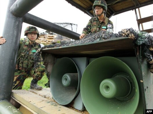 South Korean soldiers stand by loudspeakers at a guard post near the demilitarized zone separating the two Koreas in Yanggu on May 24.