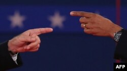 U.S. -- President Barack Obama and Republican presidential candidate Mitt Romney (L) gesture during a town hall style debate at Hofstra University in Hempstead, New York, 16Oct2012