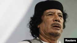 Libyan leader Muammar Qaddafi gives a speech in Rome in August 2010.